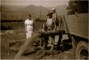 Joni (Florence), Anne, Elmer and Aleta Friend with the test pumping new well during the drought, 1951.