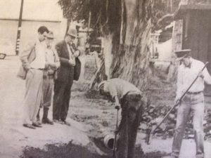 In January, 1954, Mayor Ken Praire, City Engineer Major John Dron, and another official watch workers fix the parking lot drainage behind the Arcade. (Bill Klamser, Jr,, photo, OVN)