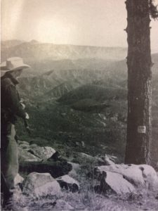 A hunter overlooks the rugged valley of the Sespe River. Behind that range of mountains beyond the river is Ojai.