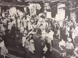 FIRST FOLK DANCE FESTIVAL -- in 1946 was held on Ojai avenue in front of the Civic Center Park entrance. Note the musicians playing atop the fountain in the center. The landmark park entrance was torn down in 1971, having been damaged by vandals.