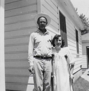 Clyde Mashburn and his daughter-in-law, Arlou Mashburn, months after the horrific automobile accident. Notice Arlou is using crutches. This photo was taken just days after Arlou was released from the hospital. Photo taken at Clyde's S. Lomita Avenue home in Meiners Oaks in 1954 or 1955.