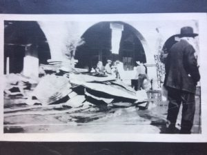 Fire damaged items piled on Ojai Avenue from the November 28, 1917 Arcade Fire.